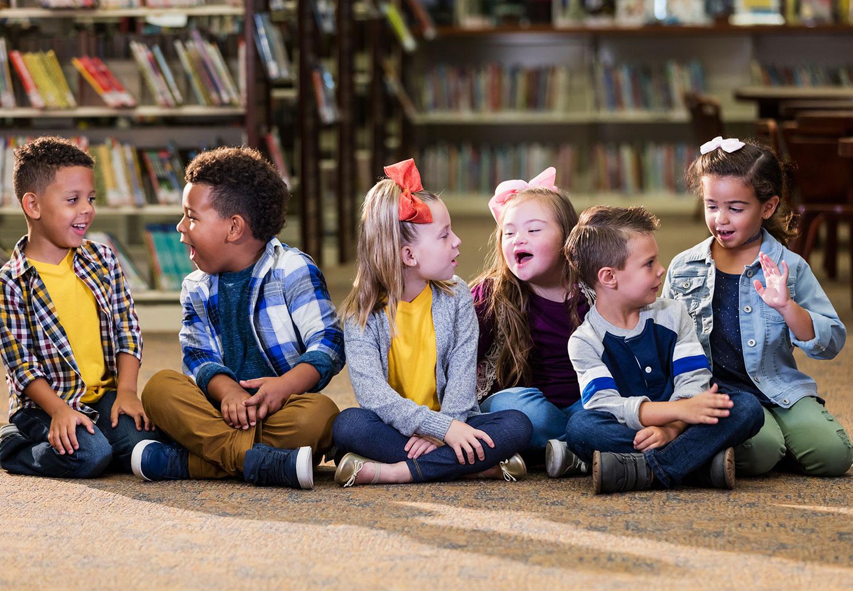 Children sitting together smiling